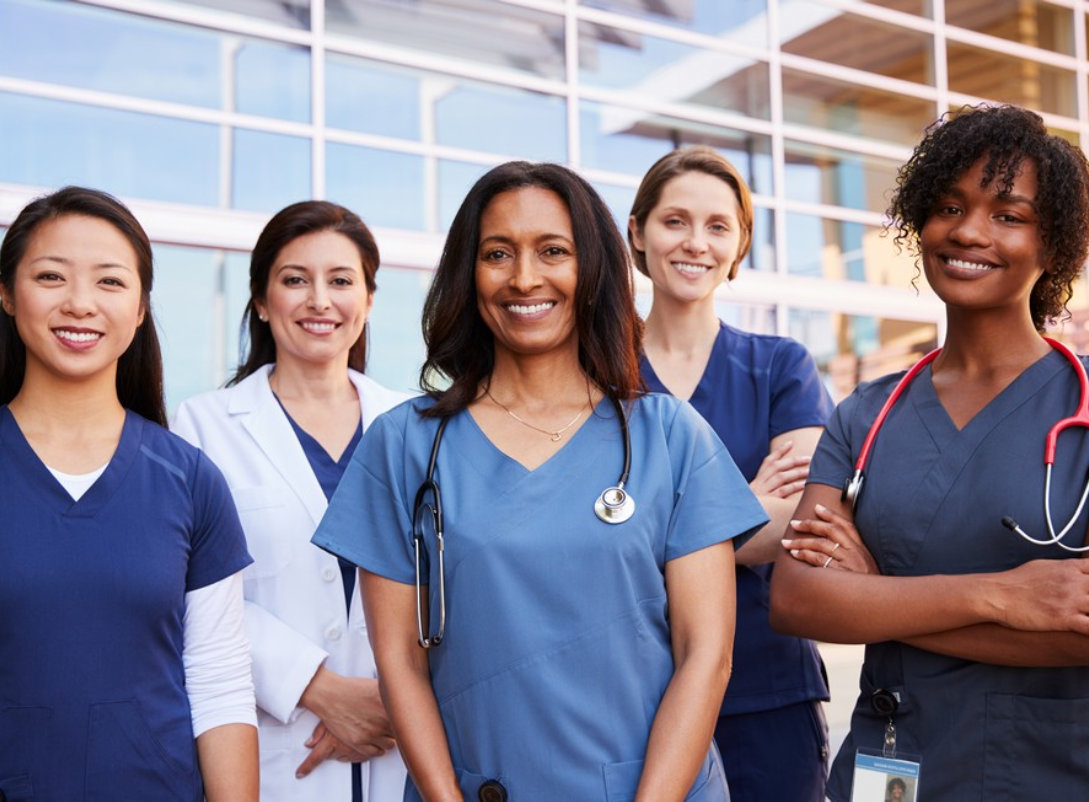 group of female medical staff smiling at the camera